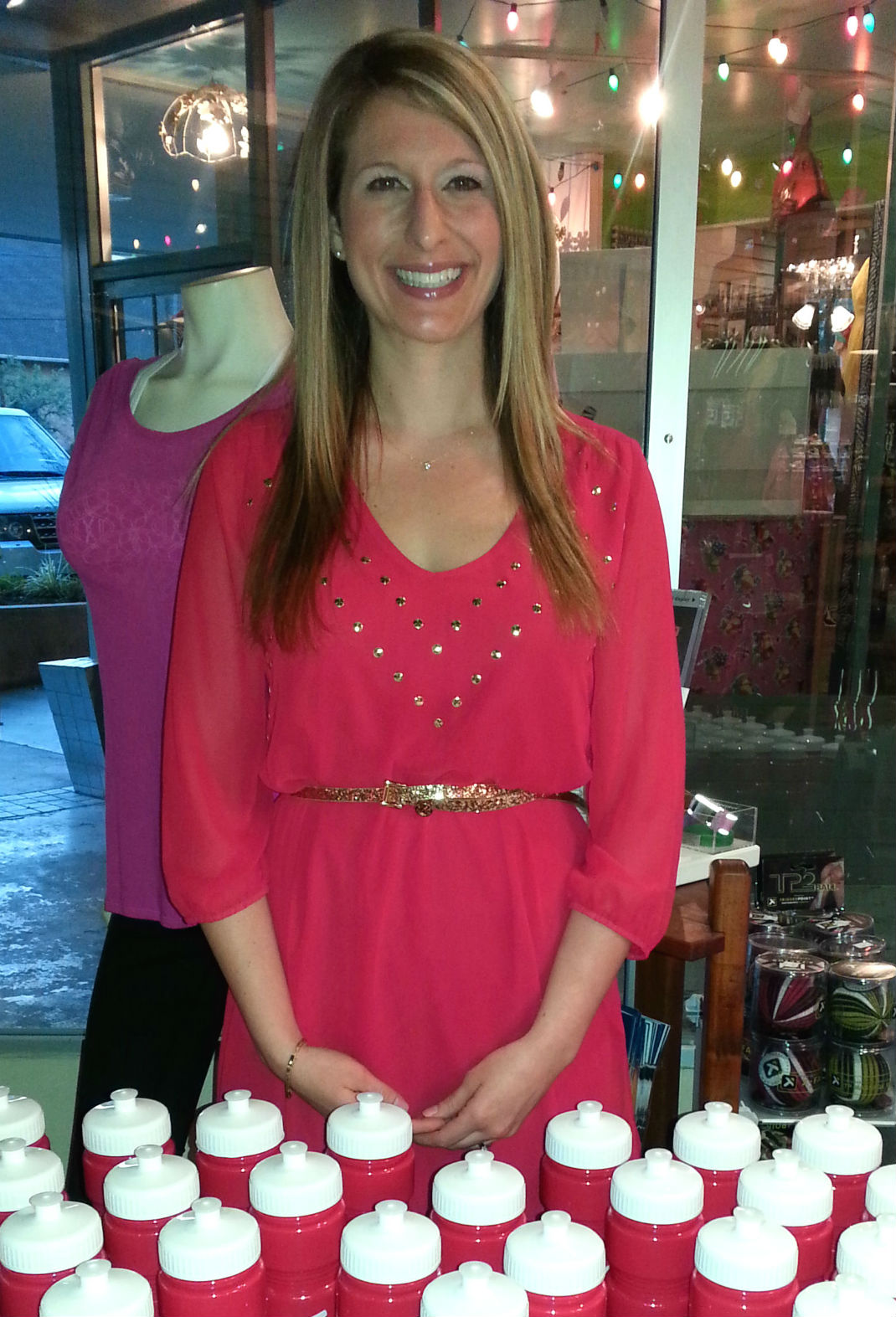 Woman in pink dress smiling